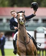 12 August 2017; Co-winner Christopher Megahey of Ireland celebrates on Seapatrick Cruise Cavalier after clearing the highest obstacle in the Land Rover Puissance during the Dublin International Horse Show at RDS, Ballsbridge in Dublin. Photo by Cody Glenn/Sportsfile