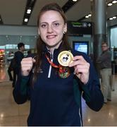 13 August 2017; Ireland team member Michaela Walsh, from Belfast who won Gold, in Dublin airport after her return home with team Ireland from the European Union Elite Women's Boxing Championships at Dublin Airport. Photo by Matt Browne/Sportsfile
