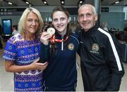 13 August 2017; Ireland team member Michaela Walsh, from Belfast, who won Gold, with her mother Martine and dad Damien after her return home with team Ireland from the European Union Elite Women's Boxing Championships at Dublin Airport. Photo by Matt Browne/Sportsfile