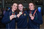 13 August 2017; Ireland team member's Michaela Walsh, centre, from Belfast who won Gold, Kellie Harrington, left, from Dublin who won silver and Grainne Walsh, from Tullamore who won Bronze in Dublin airport after their return home with team Ireland from the European Union Elite Women's Boxing Championships at Dublin Airport. Photo by Matt Browne/Sportsfile
