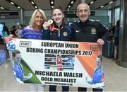 13 August 2017; Ireland team member Michaela Walsh, from Belfast who won Gold, with her mother Martine and dad Damien after her return home with team Ireland from the European Union Elite Women's Boxing Championships at Dublin Airport. Photo by Matt Browne/Sportsfile