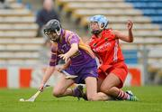 6 May 2012; Catherine O'Loughlin, Wexford, in action against Regina Curtin, Cork. National Camogie League, Division 1 Final, Cork v Wexford, Semple Stadium, Thurles, Co. Tipperary. Picture credit: Stephen McCarthy / SPORTSFILE