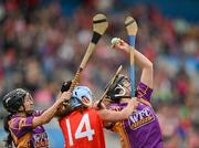 6 May 2012; Catherine O'Loughlin, right, and Claire O'Connor, Wexford, in action against Regina Curtin, Cork. National Camogie League, Division 1 Final, Cork v Wexford, Semple Stadium, Thurles, Co. Tipperary. Picture credit: Stephen McCarthy / SPORTSFILE
