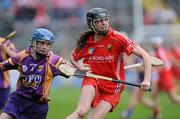 6 May 2012; Orla Cotter, Cork, in action against Josie Dwyer, Wexford. National Camogie League, Division 1 Final, Cork v Wexford, Semple Stadium, Thurles, Co. Tipperary. Picture credit: Matt Browne / SPORTSFILE