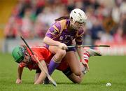 6 May 2012; Mary Leacy, Wexford, in action against Julia White, Cork. National Camogie League, Division 1 Final, Cork v Wexford, Semple Stadium, Thurles, Co. Tipperary. Picture credit: Stephen McCarthy / SPORTSFILE