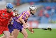 6 May 2012; Kate Kelly, Wexford, in action against Briege Corkery, Cork. National Camogie League, Division 1 Final, Cork v Wexford, Semple Stadium, Thurles, Co. Tipperary. Picture credit: Matt Browne / SPORTSFILE