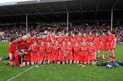 6 May 2012; The Cork squad celebrate with the cup. National Camogie League, Division 1 Final, Cork v Wexford, Semple Stadium, Thurles, Co. Tipperary. Picture credit: Matt Browne / SPORTSFILE