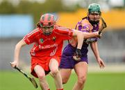 6 May 2012; Katriona Mackey, Cork, in action against Noleen Lambert, Wexford. National Camogie League, Division 1 Final, Cork v Wexford, Semple Stadium, Thurles, Co. Tipperary. Picture credit: Gareth Williams / SPORTSFILE