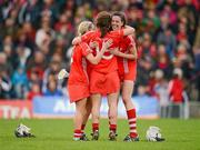 6 May 2012; Cork players, from left, Joanne O'Callaghan, Jennifer O'Leary and Orla Cotter celebrate their side's victory. National Camogie League, Division 1 Final, Cork v Wexford, Semple Stadium, Thurles, Co. Tipperary. Picture credit: Stephen McCarthy / SPORTSFILE
