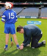 8 May 2012; Cian Gearon, Mary Mother of Hope, has his laces tied by Dublin footballer Declan Lally, who won an All-Ireland senior football medal in 2011. Allianz Cumann na mBunscol Finals, Scoil Holy Trinity v Mary Mother of Hope, Croke Park, Dublin. Picture credit: Ray McManus / SPORTSFILE