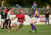 15 August 2017;  Lee Chin, Wexford hurler, representing Davy Russell's Best, in action against TJ Reid, Kilkenny hurler, representing Jim Bolger's Stars, during the sixth annual Hurling for Cancer Research game, a celebrity hurling match in aid of the Irish Cancer Society in St Conleth's Park, Newbridge. The event, organised by legendary racehorse trainer Jim Bolger and National Hunt jockey Davy Russell, has raised €540,000 to date to fund the Irish Cancer Society's innovative cancer research projects. St. Conleth's Park, Newbridge, Co Kildare. Photo by Piaras Ó Mídheach/Sportsfile