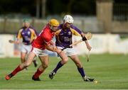 15 August 2017; Johnny Fogarty, representing Jim Bolger's Stars, right, in action against Colin Fennelly, Kilkenny hurler, representing Davy Russell's Best, at the sixth annual Hurling for Cancer Research game, a celebrity hurling match in aid of the Irish Cancer Society in St Conleth's Park, Newbridge. The event, organised by legendary racehorse trainer Jim Bolger and National Hunt jockey Davy Russell, has raised €540,000 to date to fund the Irish Cancer Society's innovative cancer research projects. St. Conleth's Park, Newbridge, Co Kildare. Photo by Piaras Ó Mídheach/Sportsfile