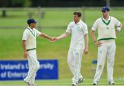 17 August 2017; Peter Chase of Ireland, centre, is congratulated by John Anderson, left, after bowling out Shane Snater of Netherlands during the ICC Intercontinental Cup match between Ireland and Netherlands at Malahide in Co Dublin. Photo by Sam Barnes/Sportsfile