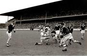 1960; Ollie Ryan, Louth, gets ready to pass the ball to Stephen White. Leinster Senior Football Championship Final, Offaly v Louth, Croke Park, Dublin. Picture credit: Connolly Collection / SPORTSFILE