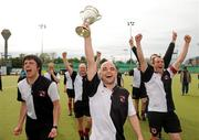 13 May 2012; Dave Eakins, Cork Harlequins, and team-mates celebrate with the cup. Men's Irish Senior Cup Final, Railway Union v Cork Harlequins, National Hockey Stadium, UCD, Belfield, Dublin. Picture credit: Stephen McCarthy / SPORTSFILE