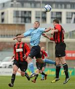 13 May 2012; Mark O'Sullivan, Avondale FC, in action against Daniel Ennis, right, and Declan Carroll, Cherry Orchard FC. FAI Umbro Intermediate Cup, Cherry Orchard FC v Avondale FC, Tallaght Stadium, Tallaght, Co. Dublin. Picture credit: Tomas Greally / SPORTSFILE