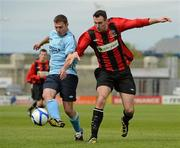 13 May 2012; Mark O'Sullivan, Avondale FC, in action agains Daniel Ennis, Cherry Orchard FC. FAI Umbro Intermediate Cup, Cherry Orchard FC v Avondale FC, Tallaght Stadium, Tallaght, Co. Dublin. Picture credit: Tomas Greally / SPORTSFILE