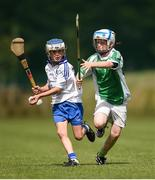 19 August 2017; Brian Scanlon from Aglish-Ballinameela, Co Waterford, in action against  Cathal Diver, from Gweedore, Co Donegal, during their U11 hurling match during day 1 of the Aldi Community Games August Festival 2017 at the National Sports Campus in Dublin. Photo by Cody Glenn/Sportsfile