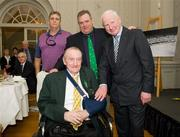 9 March 2012; Dr. Pat Hickey, President of the OCI, with Jimmy Reardon, athletics, a member of the 1948 Olympic Team, and his Olympic Medal of Honour, and his sons Robert Reardon, left, and James P. Reardon, centre. Farmleigh House, Phoenix Park, Dublin 15. Picture credit: Ray McManus / SPORTSFILE