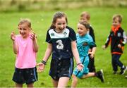 20 August 2017; Parkrun Ireland, in partnership with Vhi, expanded their range of junior events to ten with the introduction of the Oranmore Junior Parkrun on Sunday morning. Junior parkruns are 2km long and cater for 4 to 14 year olds, free of charge providing a fun and safe environment for children to enjoy exercise. To register for a parkrun near you visit www.parkrun.ie. New registrants should select their chosen event as their home location. You will then receive a personal barcode which acts as your free entry to any parkrun event worldwide. Pictured enjoying the water spray from the Fire Brigade's hose after the Oranmore Junior Parkrun, in partnership with Vhi are Amy McNally, aged 6, left, Abby McNally, aged 9, from Oranmore. Rinville Park, Oranmore, Co Galway. Photo by Diarmuid Greene/Sportsfile