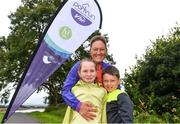 20 August 2017; Parkrun Ireland, in partnership with Vhi, expanded their range of junior events to ten with the introduction of the Oranmore Junior Parkrun on Sunday morning. Junior parkruns are 2km long and cater for 4 to 14 year olds, free of charge providing a fun and safe environment for children to enjoy exercise. To register for a parkrun near you visit www.parkrun.ie. New registrants should select their chosen event as their home location. You will then receive a personal barcode which acts as your free entry to any parkrun event worldwide. Pictured at the Oranmore Junior Parkrun, in partnnership with Vhi are Rachel Conroy, aged 8, and Ruaidhri Conroy, aged 7, along with their mother Edel Conroy, from 'Gotta Run', Galway. Rinville Park, Oranmore, Co Galway. Photo by Diarmuid Greene/Sportsfile