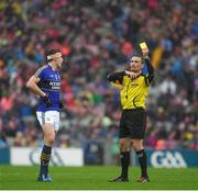 20 August 2017; Referee Maurice Deegan indicates why he had shown a yellow card to David Moran of Kerry  during the GAA Football All-Ireland Senior Championship Semi-Final match between Kerry and Mayo at Croke Park in Dublin. Photo by Ray McManus/Sportsfile