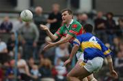 27 July 2002; James Horan, Mayo, in action against Damian Byrne, Tipperary. Mayo v Tipperary, Bank of Ireland Football Qualifiers Round 4, Cusack Park, Ennis, Co. Clare. Picture credit; Damien Eagers / SPORTSFILE *EDI*