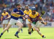 11 August 2002; Joe Codd, Wexford, in action against Tipperary's Francis Devanney. Tipperary v Wexford, All Ireland Minor Hurling Semi - Final, Croke Park, Dublin. Picture credit; Brian Lawless / SPORTSFILE