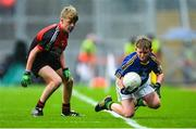 20 August 2017; David Hanlon of Scoil Mhuire na Trócaire, Co Cork, representing Kerry, in action against Matthew Flynn of Scoil Mhuire National School, Co Longford, representing Mayo, during the INTO Cumann na mBunscol GAA Respect Exhibition Go Games at half time during the GAA Football All-Ireland Senior Championship Semi-Final match between Kerry and Mayo at Croke Park in Dublin. Photo by Piaras Ó Mídheach/Sportsfile