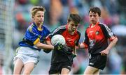 20 August 2017; Jack Bookle of Scoil Naomh Mhuire, Co Wicklow, representing Mayo, in action against Robert Brooks of Fossa National School, Co Kerry, during the INTO Cumann na mBunscol GAA Respect Exhibition Go Games at half time during the GAA Football All-Ireland Senior Championship Semi-Final match between Kerry and Mayo at Croke Park in Dublin. Photo by Piaras Ó Mídheach/Sportsfile