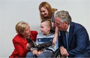 22 August 2017; Tánaiste Frances Fitzgerald TD, left, and FAI Chief Executive John Delaney, right, look at the Football For All booklet with James Casserly, aged 11, from Lucan, Co. Dublin and his mother Vicky Casserly during the Football For All Strategic Plan Launch at the Marker Hotel in Dublin. Photo by David Fitzgerald/Sportsfile