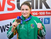 20 May 2012; Ireland's Katie Taylor, who won a gold medal and the Best Boxer award at AIBA World Women's Boxing Championships and qualification for the London 2012 Olympic Games, on her arrival in Dublin Airport following the Boxing Championships in China. Dublin Airport, Dublin. Picture credit: Daire Brennan / SPORTSFILE
