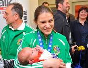 20 May 2012; Ireland's Katie Taylor meets her 5 day old niece Madeline Hope-Taylor for the first time on her arrival at Dublin airport following the Boxing Championships in China. Taylor won a gold medal and the Best Boxer award at AIBA World Women's Boxing Championships and qualification for the London 2012 Olympic Games. Dublin Airport, Dublin. Picture credit: Daire Brennan / SPORTSFILE