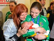 20 May 2012; Ireland's Katie Taylor, meets her 5 day old niece Madeline Hope-Taylor for the first time on her arrival at Dublin airport following the Boxing Championships in China, with Katie's mother Bridget. Taylor won a gold medal and the Best Boxer award at AIBA World Women's Boxing Championships and qualification for the London 2012 Olympic Games. Dublin Airport, Dublin. Picture credit: Daire Brennan / SPORTSFILE