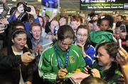 20 May 2012; Ireland's Katie Taylor, who won a gold medal and the Best Boxer award at AIBA World Women's Boxing Championships and qualification for the London 2012 Olympic Games, signs autographs for fans on her arrival in Dublin Airport following the Boxing Championships in China. Dublin Airport, Dublin. Picture credit: Daire Brennan / SPORTSFILE