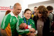 20 May 2012; Ireland's Katie Taylor, who won a gold medal and the Best Boxer award at AIBA World Women's Boxing Championships and qualification for the London 2012 Olympic Games, on her arrival in Dublin Airport, with her father Pete, her 5 day old niece Madeline Hope-Taylor, and Madeline's Mother Kim, following the Boxing Championships in China. Dublin Airport, Dublin. Picture credit: Daire Brennan / SPORTSFILE
