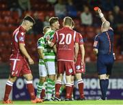 25 August 2017; Ronan Finn of Shamrock Rovers speaks with referee Robert Rogers after being sent off following a second booking during the Irish Daily Mail FAI Cup Second Round match between Shelbourne and Shamrock Rovers at Tolka Park, in Dublin. Photo by David Fitzgerald/Sportsfile