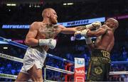 26 August 2017; Conor McGregor, left, and Floyd Mayweather Jr during their super welterweight boxing match at T-Mobile Arena in Las Vegas, USA. Photo by Stephen McCarthy/Sportsfile