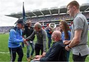 27 August 2017; Dublin manager Jim Gavin shakes hands with Tyrone manager Mickey Harte, alongside former Antrim footballer Anto Finnegan and his children Conall and Ava ahead of the GAA Football All-Ireland Senior Championship Semi-Final match between Dublin and Tyrone at Croke Park in Dublin. Photo by Ramsey Cardy/Sportsfile