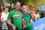 26 May 2012; Ireland's Aileen Morrison celebrates with Triathlon Ireland Performance Director Chris Jones after winning a silver medal in the Women's Triathlon in a time of 2:06:37. 2012 ITU World Triathlon Madrid, Casa de Campo Park, Madrid, Spain. Picture credit: Paul Mohan / SPORTSFILE