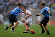 27 August 2017; Danny Diver of St Patricks, Co Donegal, representing Tyrone, in action against Dan Twomey of Scoil San Treasa, Co Dublin, and Jack Slevin of St. Mary's NS, Co Offaly, representing Dublin, right, during the INTO Cumann na mBunscol GAA Respect Exhibition Go Games at Dublin v Tyrone - GAA Football All-Ireland Senior Championship Semi-Final at Croke Park in Dublin. Photo by Piaras Ó Mídheach/Sportsfile