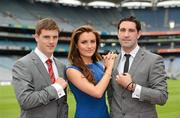 29 May 2012; Bryan Sheehan, Kerry, right, and Eoin Cadogan, Cork, with model Holly Carpenter in attendance at the launch by TJH Jewellery of their exclusive 'Love Your County' GAA jewellery collection. Croke Park, Dublin. Picture credit: Ray McManus / SPORTSFILE