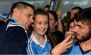 30 August 2017; Dublin footballer Stephen Cluxton takes a photograph with Allannah Daly, from Tallaght, during a meet and greet with supporters at Parnell Park in Dublin. Photo by Piaras Ó Mídheach/Sportsfile