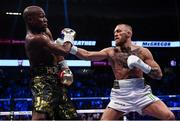 26 August 2017; Conor McGregor, right, and Floyd Mayweather Jr during their super welterweight boxing match at T-Mobile Arena in Las Vegas, USA. Photo by Stephen McCarthy/Sportsfile
