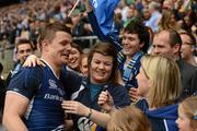 19 May 2012; Brian O'Driscoll, Leinster, is congratulated by his sisters Susan, centre, and Julie, right, following his side's victory. Heineken Cup Final, Leinster v Ulster, Twickenham Stadium, Twickenham, England. Picture credit: Stephen McCarthy / SPORTSFILE