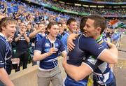 19 May 2012; John Cooney, Leinster, celebrates with supporters following his side's victory. Heineken Cup Final, Leinster v Ulster, Twickenham Stadium, Twickenham, England. Picture credit: Stephen McCarthy / SPORTSFILE