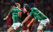 1 September 2017; Jean Kleyn of Munster is tackled by Tito Tebaldi, left, and Marco Lazzaroni of Benetton during the Guinness PRO14 Round 1 match between Munster and Benetton at Irish Independent Park in Cork. Photo by Eóin Noonan/Sportsfile
