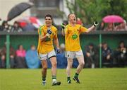 3 June 2012; Emlyn Mulligan, left, and Ray Cox, Leitrim, celebrate at the final whistle after victory over London. Connacht GAA Football Senior Championship Quarter-Final, London v Leitrim, Emerald Park, Ruislip, London. Picture credit: Diarmuid Greene / SPORTSFILE