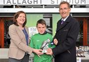 """5 June 2012; Aaron Connolly, Brierhill NS, Co. Galway, receives the player of the tournament award in the """"B"""" Boy's Schools category from Miriam Malone, FAI Grass Roots and Barney Whelan, Director of Communications and Corperate Affairs with An Post. An Post FAI Primary Schools 5-a-Side All-Ireland Finals, Tallaght Stadium, Tallaght, Dublin. Picture credit: Barry Cregg / SPORTSFILE"""