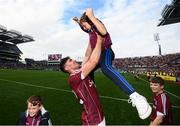 3 September 2017; Jason Flynn of Galway celebrates with Jody Canning, nephew of Joe Canning, following the GAA Hurling All-Ireland Senior Championship Final match between Galway and Waterford at Croke Park in Dublin. Photo by Stephen McCarthy/Sportsfile